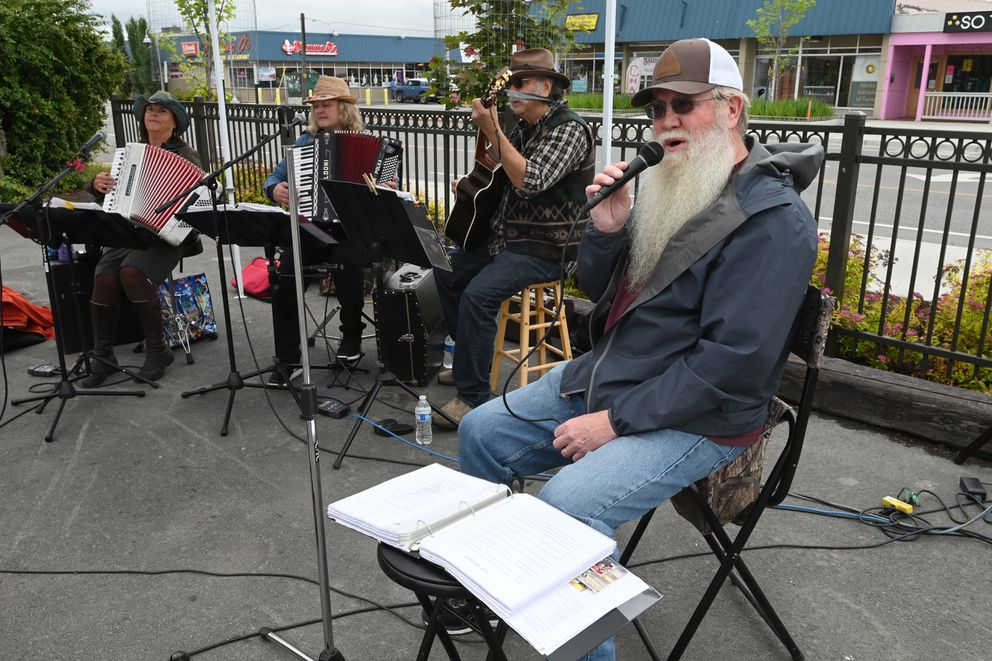 Gary Stevens sang with the accordion group Alaska Main Squeeze during the Spenard Food Truck Carnival under the windmill in Spenard on Thursday, July 9, 2020. (Bill Roth / ADN)