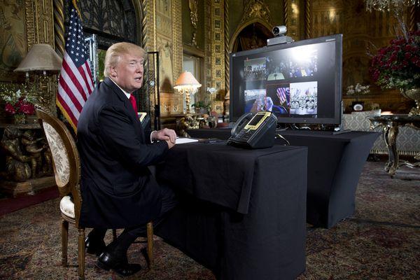 President Donald Trump makes a video call to military personnel at the Mar-a-Lago estate in Palm Beach, Fla., Dec. 24, 2017. (Tom Brenner/The New York Times)