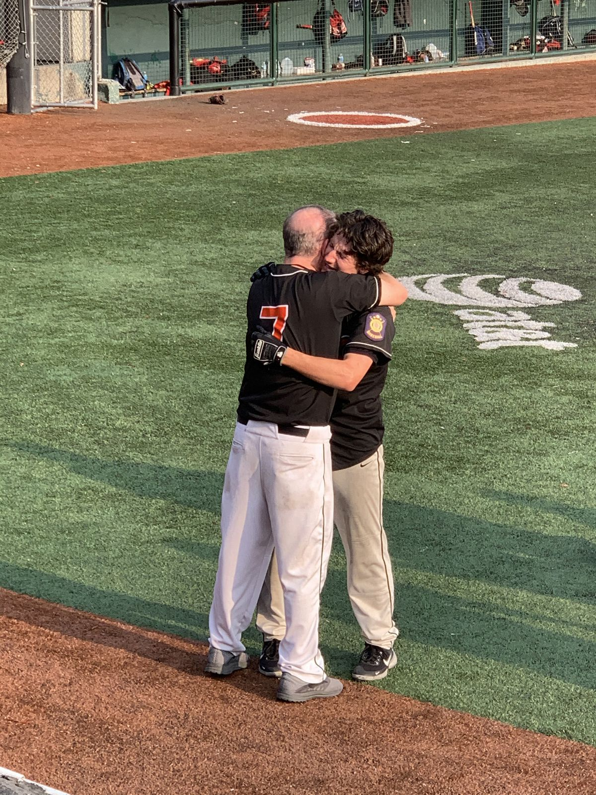 Jack Opinsky embraces his dad, John Opinsky, after his walkoff single lifted the West Eagles to their first state baseball title since 1977. (Photo by Cathy Opinsky)