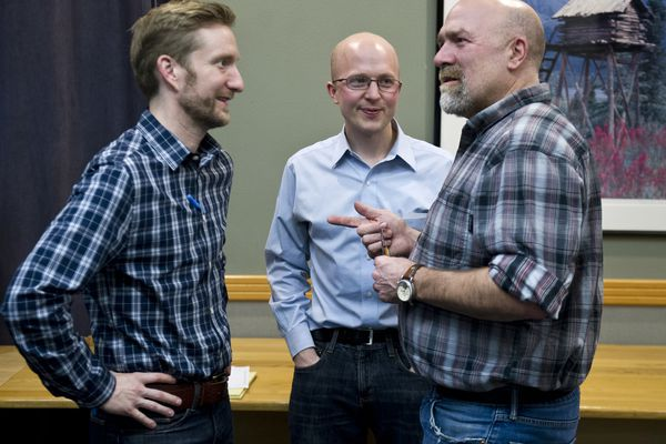 Representitive-elect Jason Grenn, of Anchorage, talks with Reps. Jonathan Kreiss-Tomkins of Sitka, center, and Adam Wool, of Fairbanks. Alaska House representatives announced a 22-member majority coalition made up of Democrats, Republicans and independents on Wednesday, November 9, 2016, at the Dimond Center Hotel in Anchorage. (Marc Lester / Alaska Dispatch News)