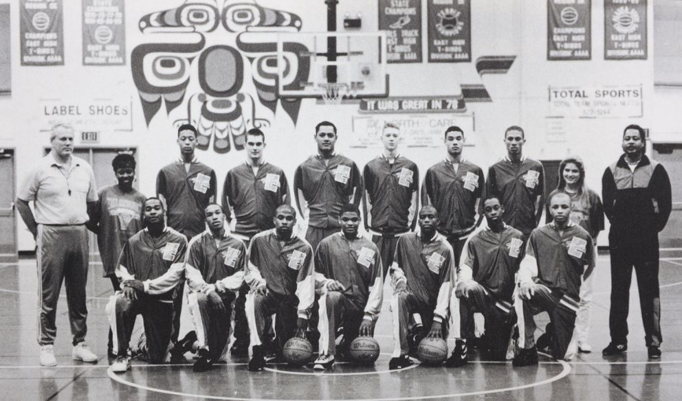 East High senior James Ritchie, fourth from left in back row, played on the state champion East High basketball team with Mao Tosi, fifth from left back row, and Trajan Langdon, fourth from right back row. (1994 East High yearbook)