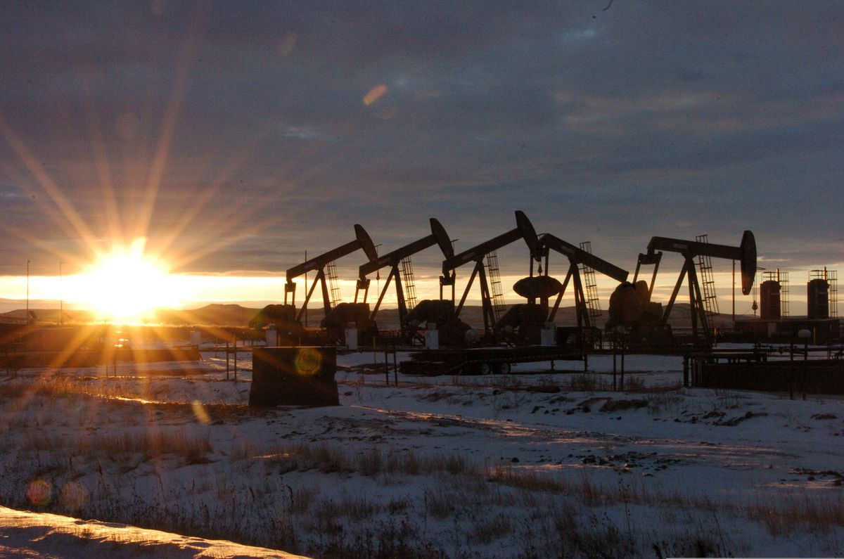 FILE - In this Jan. 14, 2015, file photo, oil pump jacks are seen in McKenzie County, in western North Dakota. The Biden administration said Tuesday, March 9, 2021, that it will deliver an interim report on its suspension of oil and gas sales from federal lands and waters by summer, but officials declined to state how long the moratorium could remain in place. (AP Photo/Matthew Brown, File)