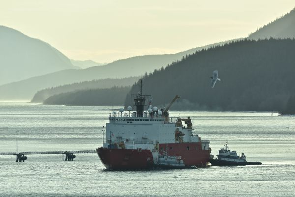 The Coast Guard Cutter Healy and crew make way towards the Alaska Steamship Dock in Juneau, Alaska, Nov. 14, 2017. The crew of the cutter Healy just concluded a five-month deployment in the Arctic and after their brief stop in Juneau, will continue enroute their homeport of Seattle. Coast Guard photo by Petty Officer 1st Class Jon-Paul Rios.
