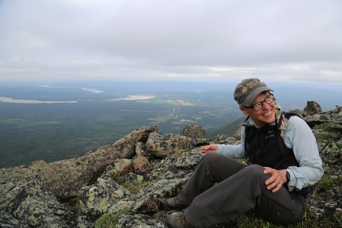 Dr. Julia Heinz takes a break from hunting to enjoy some blueberries. (Photo by Christine Cunningham)
