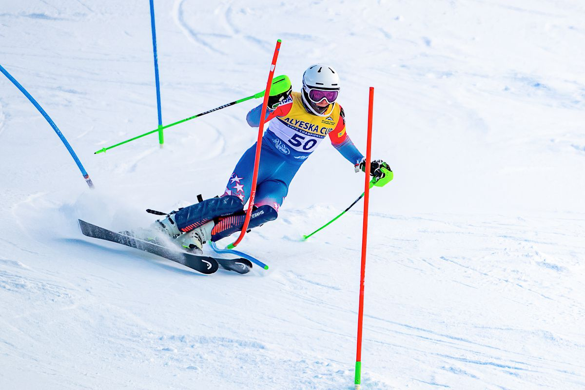 Finnigan Donley adopts a narrow -- and risky -- stance and rides on the outside edge of his inside ski to straighten out a hairpin during slalom racing Sunday on the Tanaka Hill at Alyeska Resort. The maneuver helped contribute to a winning margin of about seven seconds. (Photo by Bob Eastaugh)