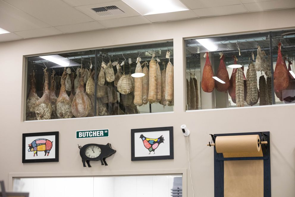 Curing meat hangs in a refrigerated store room at Butcher Block No. 9 and Charcuterie in South Anchorage on Wednesday, Nov. 30, 2016. (Loren Holmes / Alaska Dispatch News)