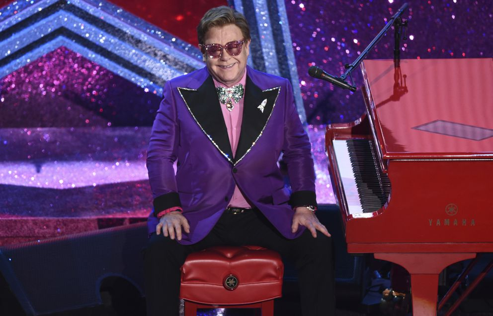 Elton John is seen after performing '(I'm Gonna) Love Me Again ' nominated for the award for best original song from 'Rocketman ' at the Oscars on Sunday, Feb. 9, 2020, at the Dolby Theatre in Los Angeles. (AP Photo/Chris Pizzello)