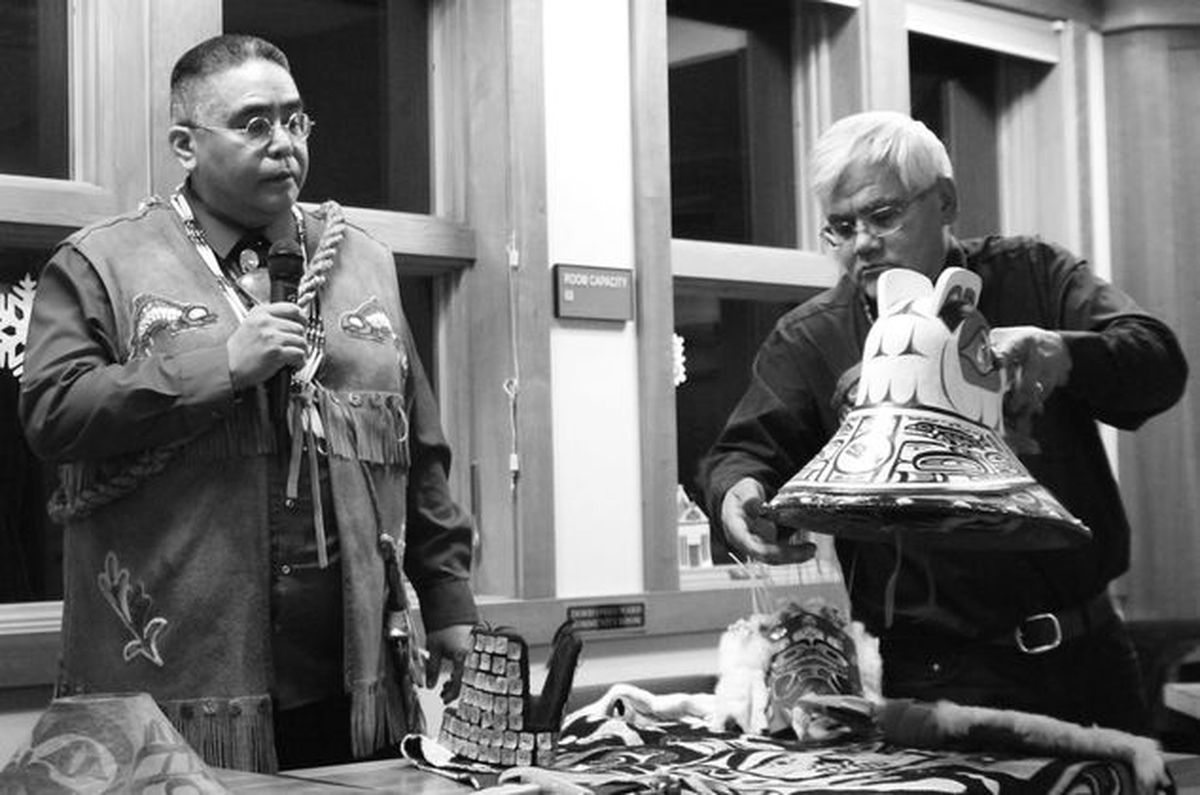 Dennis and Wayne Price discuss at.oow, the name for clan possessions including stories, regalia, songs and crests. (Kyle Clayton / Chilkat Valley News)