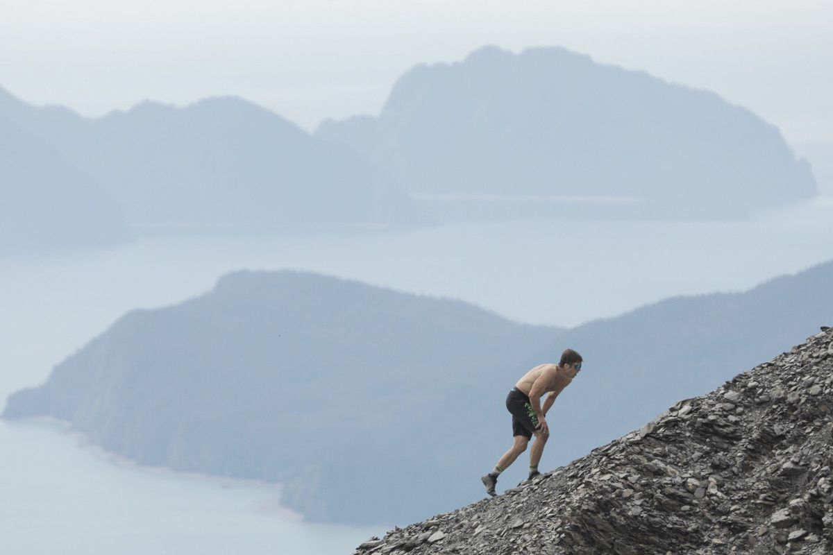 David Norris climbs up the shale field during the men's Mount Marathon race in Seward on Wednesday. (Loren Holmes / ADN)