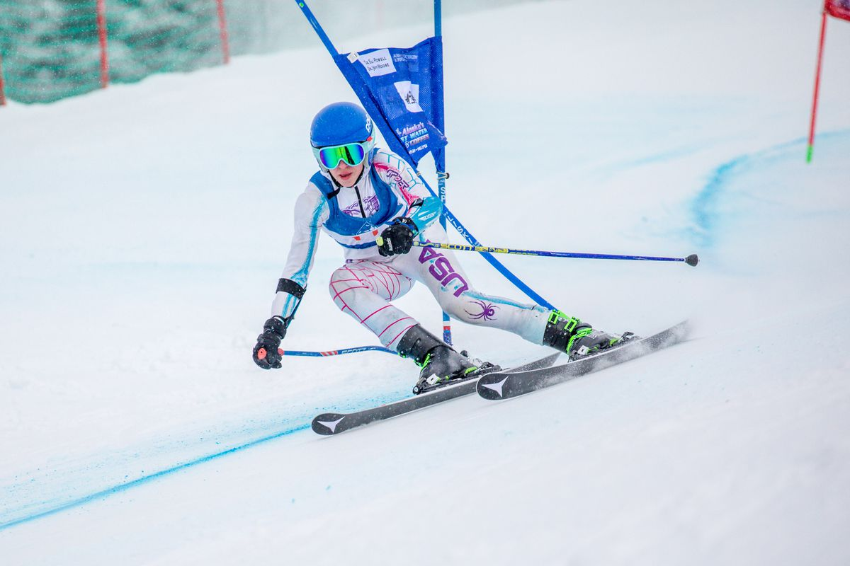 Johanna Griggs of Juneau crashes a gate while claiming the overall victory in second giant slalom race Thursday at the Alyeska Cup. (Photo by Bob Eastaugh)