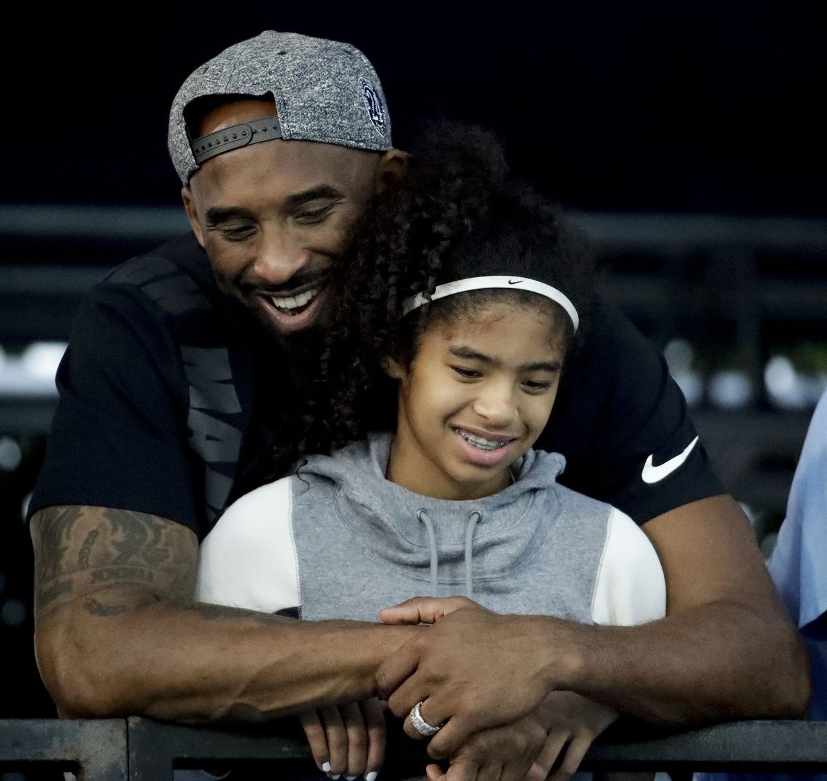 FILE - In this July 26, 2018 file photo former Los Angeles Laker Kobe Bryant and his daughter Gianna watch during the U.S. national championships swimming meet in Irvine, Calif. Bryant, the 18-time NBA All-Star who won five championships and became one of the greatest basketball players of his generation during a 20-year career with the Los Angeles Lakers, died in a helicopter crash Sunday, Jan. 26, 2020. Gianna also died in the crash. She was 13. (AP Photo/Chris Carlson)