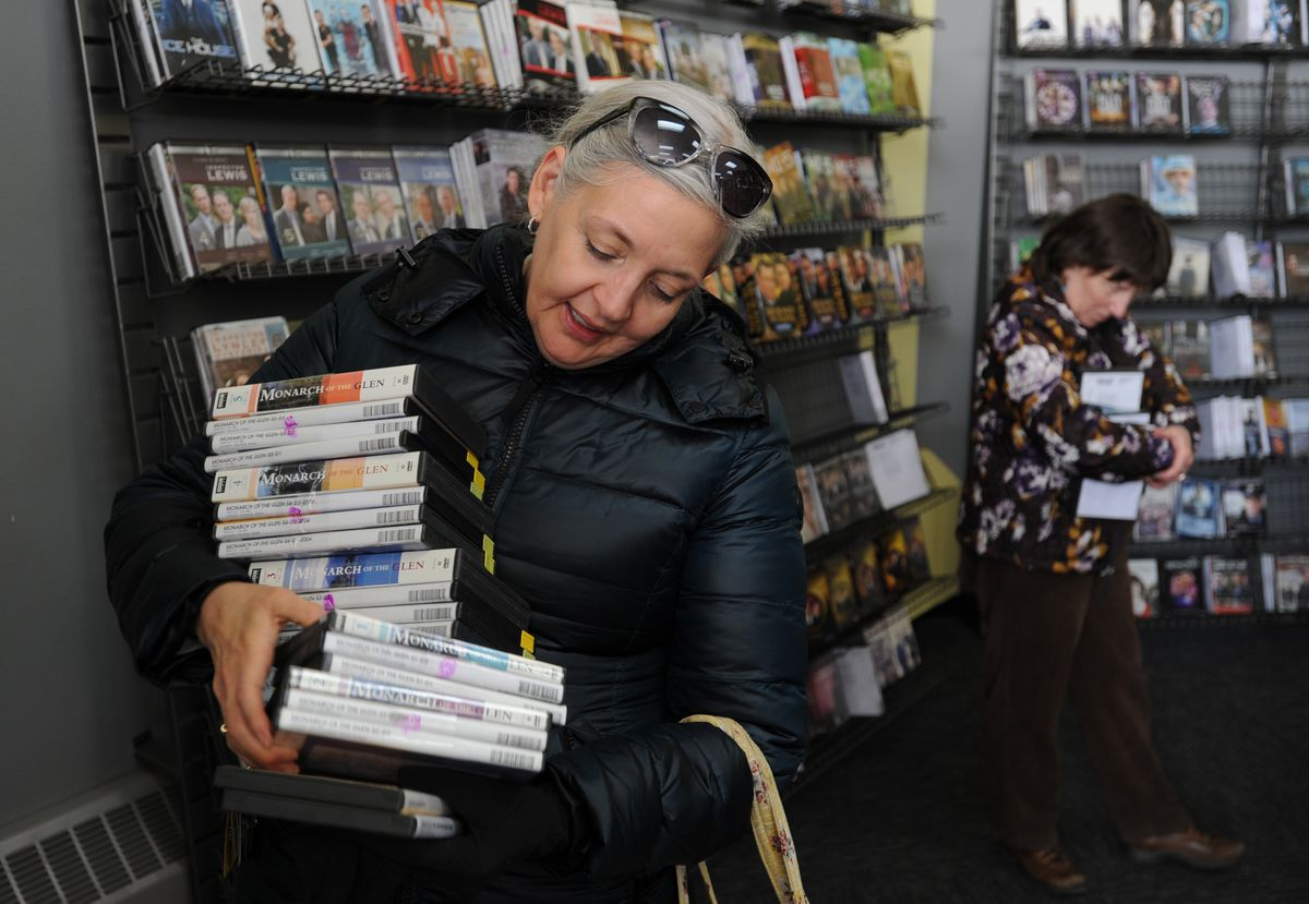 Masha Hughton purchased the BBC series Monarch of the Glen, which is based in Scotland, from the Blockbuster store at corner of Old Seward Highway and Huffman Road after it began selling its inventory on Tuesday. (Bill Roth / ADN)