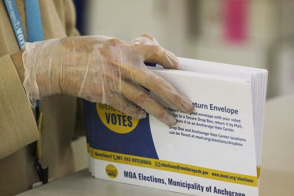 An election worker processes election ballot envelopes at the MOA Election Center in Anchorage on Wednesday, May 12, 2021. (Emily Mesner / ADN)