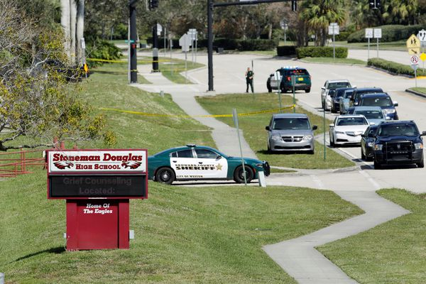 A message about grief counseling appears on an electronic signboard at Marjory Stoneman Douglas High School one day after a shooting at the school left 17 dead, in Parkland, Florida, U.S., February 15, 2018. REUTERS/Jonathan Drake
