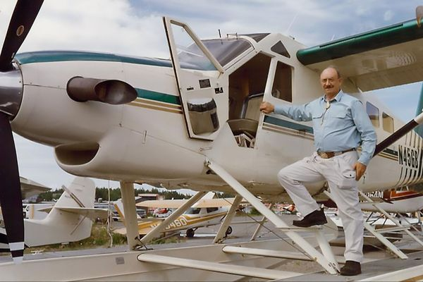 "Gene Zerkel stands on the float of N45GB, an ""Alaska Magnum Beaver"" modified by Alaska Aircraft Sales and Maintenance."
