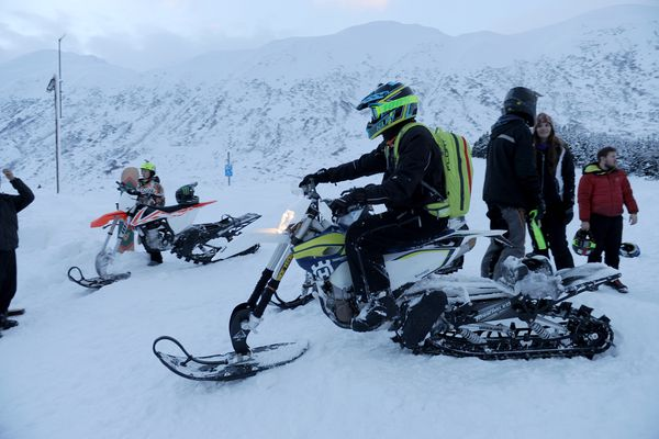 The Motorcycle Shop, of Anchorage, Alaska, brought dirt bikes with snow machine conversion kits to Turnagain pass South of Anchorage, Alaska, for people to try out on Sunday, Jan. 29, 2017. The kits replace the front wheel with a ski and the rear suspension with a snow machine track. (Bob Hallinen / Alaska Dispatch News)