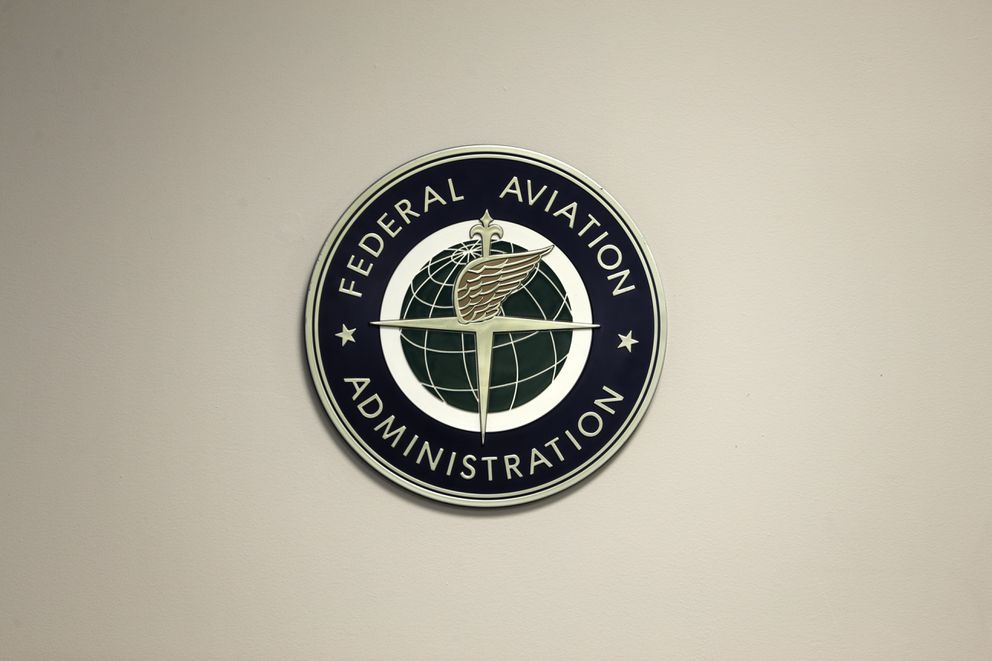 A Federal Aviation Administration sign hangs in the tower at John F. Kennedy International Airport in New York, Thursday, March 16, 2017. (AP Photo/Seth Wenig)