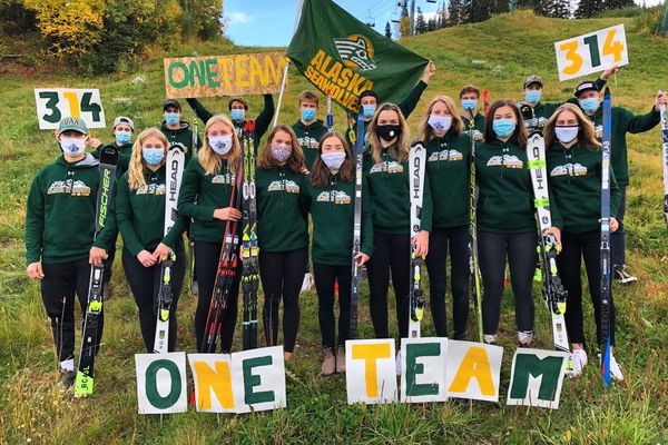 Members of the UAA ski team gather at Hilltop to demonstrate their solidarity and help kick off the 314 fundraising initiative. Each skier is holding one alpine ski and one nordic ski. (Photo by Anna Berecz)
