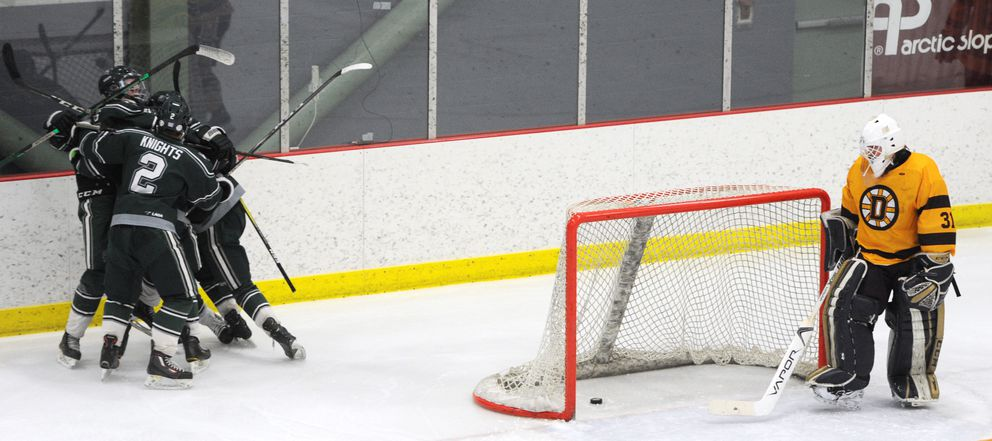 Colony Knights celebrate a goal as Dimond senior goalie Hunter Kattness looks into the net during the quarterfinals of the state hockey championships at the Menard Center in Wasilla on Thursday, Feb. 13, 2020. (Bill Roth / ADN)