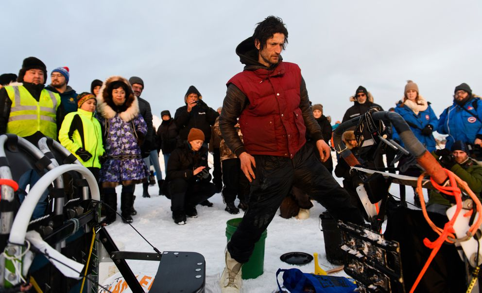 Nicolas Petit arrives in Unalakleet on Sunday morning in the lead of the Iditarod Trail Sled Dog Race. (Marc Lester / ADN)