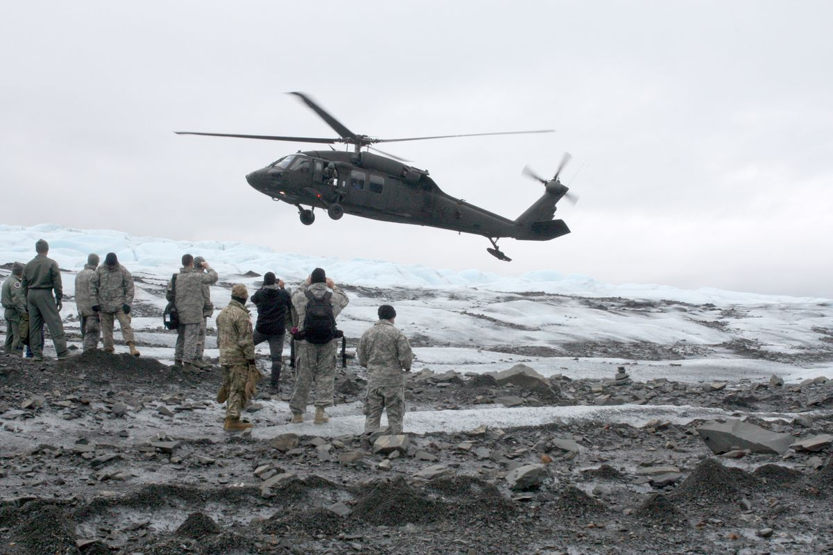 A Black Hawk helicopter lands on Colony Glacier to pick up service members. Photographed Wednesday, June 21, 2017. (Laurel Andrews / ADN)
