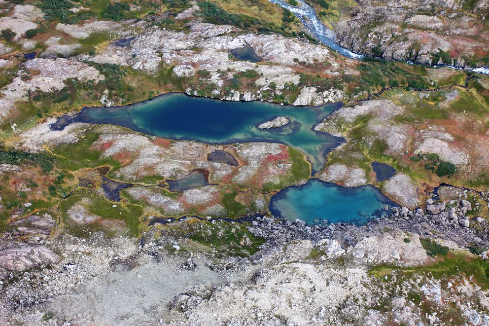 A pair or barely-separated alpine lakes in the tundra playground beyond the end of the trail.(Ground Truth Trekking)