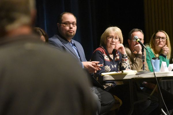 From left, Anchorage Assembly members Felix Rivera, Crystal Kennedy, John Weddleton and Meg Zaletel listen to testimony during a municipal town hall meeting at the Steve Primis Auditorium at Chugiak High School on Wednesday, Jan. 8, 2020. More than 100 people showed up to the meeting, which was also attended by assembly members Suzanne LaFrance and Fred Dyson, as well as Anchorage Mayor Ethan Berkowitz. (Matt Tunseth / Chugiak-Eagle River Star)