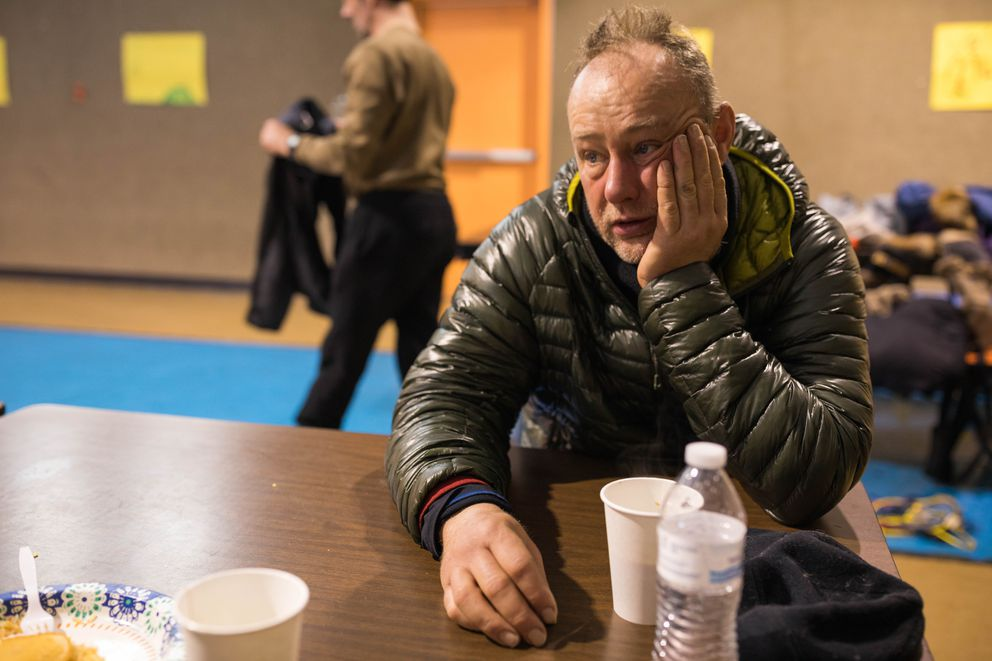 Rob Cooke rests in the Nikolai checkpoint on March 7. (Loren Holmes / ADN)