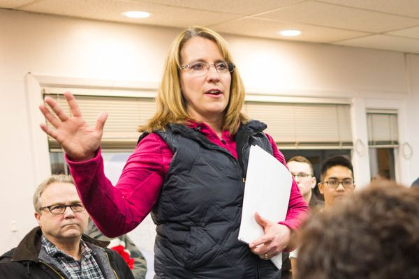 Nancy Burke, Anchorage's homeless coordinator, gives an orientation to volunteers before the annual homeless count on Jan. 27, 2016. (Loren Holmes / Alaska Dispatch News)