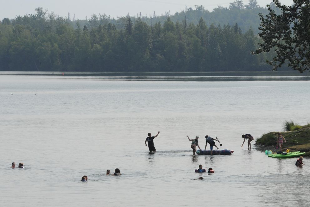 People beat the heat by getting into the water at Wasilla Lake during a smoky Monday, July 8, 2019. (Bill Roth / ADN)