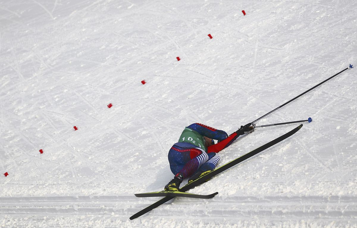 Reese Hanneman collapses after finishing his leg in the men's 4x10K relay at the Winter Olympics. (REUTERS/Carlos Barria)