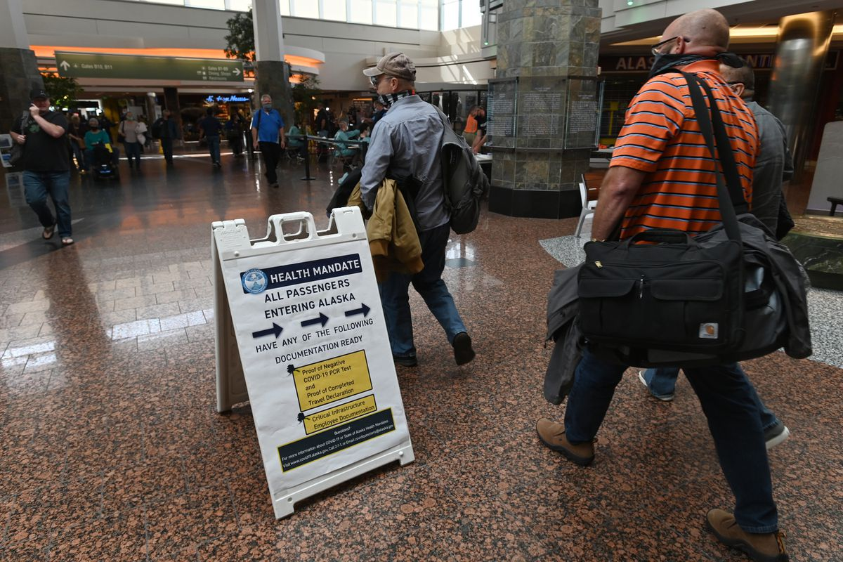 Travelers enter a screening station for at Ted Stevens Anchorage International Airport on Monday, June 22, 2020. (Bill Roth / ADN)