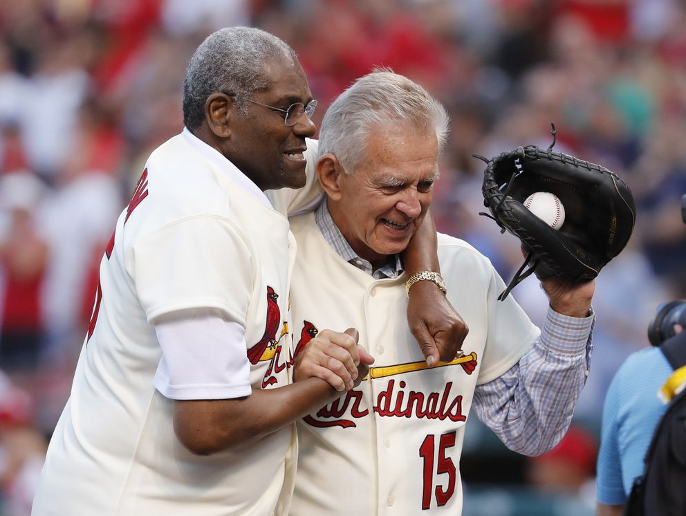 FILE - In this May 17, 2017, file photo, Bob Gibson, left, and Tim McCarver, members of the St. Louis Cardinals' 1967 World Series champion team, take part in a ceremony honoring the 50th anniversary of the victory, before a baseball game between the Cardinals and the Boston Red Sox in St. Louis. (AP Photo/Jeff Roberson, File)