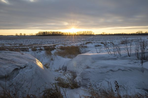 Frigid agricultural fields in St. Vincent, Minnesota, that lie along an entry route into Canada. (Photo by Benjamin Olson for The Washington Post)