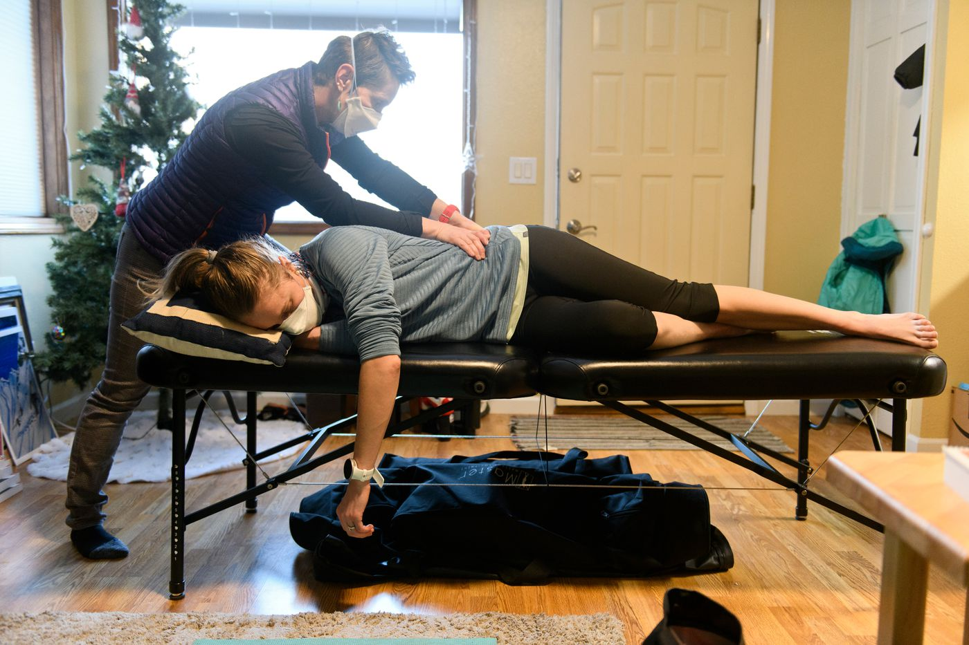 Physical therapist Zuzana Rogers works with APU cross-country skier and two-time Olympian Sadie Maubet Bjornsen on January 20, 2021. (Marc Lester / ADN)