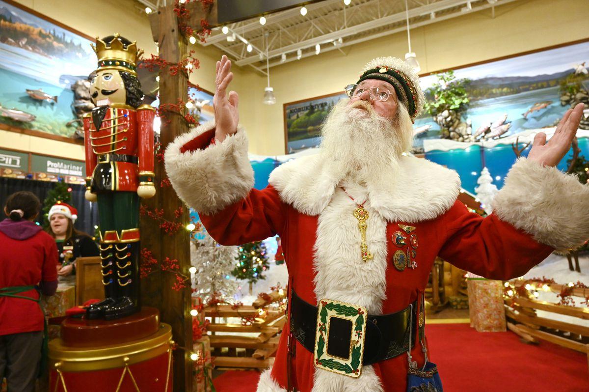 Santa Paul talks with visitors on Christmas Eve. (Anne Raup / ADN)