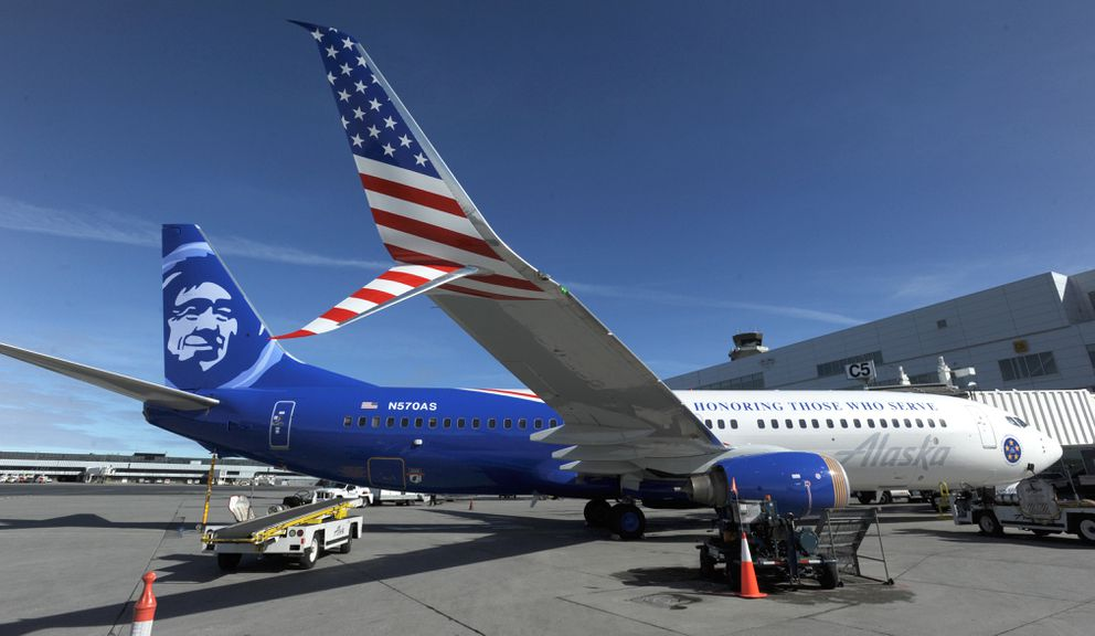 An Alaska Airlines Boeing 737-800 ETOPS is the airline's newest military-themed aircraft. Featuring a unique patriotic paint scheme and emblazoned with the words 'Honoring Those Who Serve, ' the aircraft made its inaugural flight from Ted Stevens Anchorage International Airport bound for Washington, D.C., on Tuesday with 22 veterans in the Last Frontier Honor Flight program. (Bill Roth / ADN)