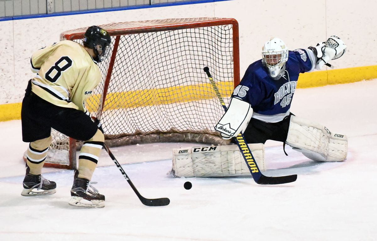 Eagle River goalie Ryan Gray makes a save on a shot by South's Hayden Fox in South's 2-1 win the third-place game of the Cook Inlet Conference hockey tournament. Both players were named to the all-CIC team. (Matt Tunseth / ADN)
