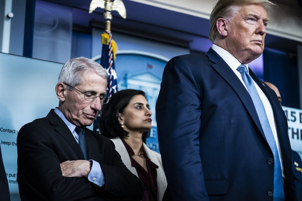 Anthony Fauci listens as President Donald Trump announces that the virus outbreak could last months. (Washington Post photo by Jabin Botsford)