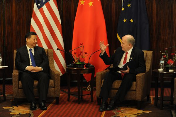 Xi Jinping, President of China and Alaska Governor Bill Walker meet at the Hotel Captain Cook on Friday, April 7, 2017. The president of China stopped over in Anchorage after meeting with President Trump at Mar-a-Lago. (Bob Hallinen / Alaska Dispatch News)