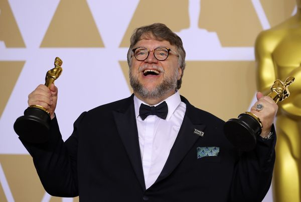 "Guillermo del Toro with the Best Director Award and the Best Picture Award for ""The Shape of Water"" REUTERS/Mike Blake"