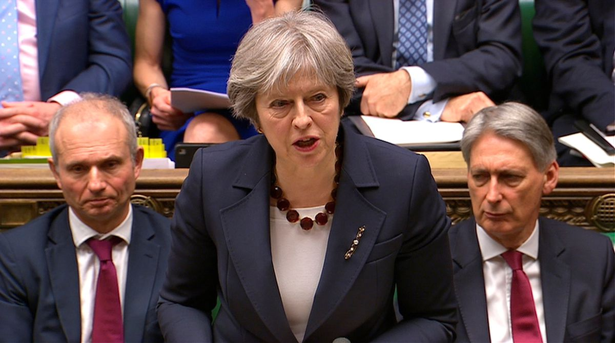 Britain's Prime Minister Theresa May addresses the House of Commons on her government's reaction to the poisoning of former Russian intelligence officer Sergei Skripal and his daughter Yulia. Parliament TV handout via REUTERS