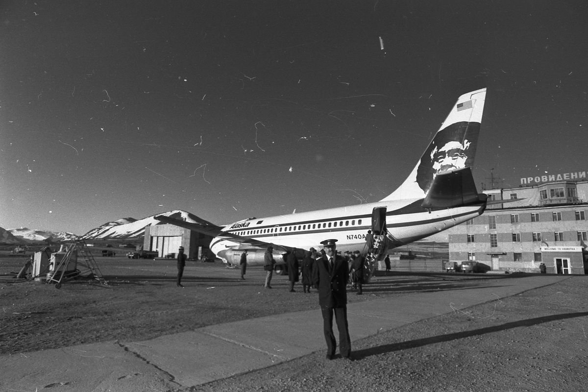 Alaska Airlines' Friendship Flight is guarded on the airstrip in Provideniya, USSR. The flight was the first by a commercial jetliner to that Bering Sea coast community at the height of the Cold War. (Photo via Provideniya Museum)