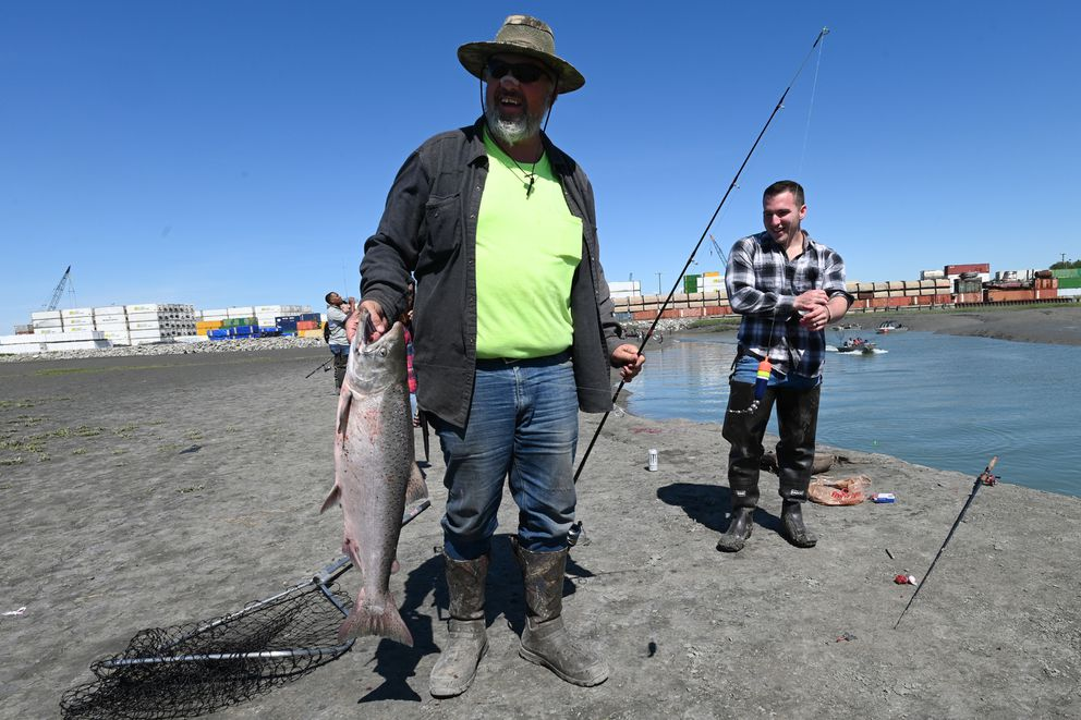 Greg Wilson caught his first ever king salmon while soaking eggs below a bobber at Ship Creek near downtown Anchorage on Sunday. 'That was a beast of a fight, ' said Wilson. (Bill Roth / ADN)