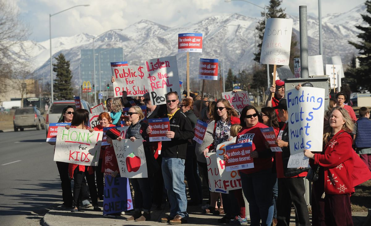 About 200 people gathered at the Legislative Information Office to advocate for increased funding for schools in Anchorage on Friday. (Bob Hallinen / ADN)