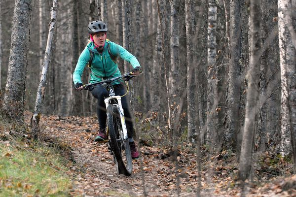 Eagle River's Heather Johnson rides on a newly completed section of trail at the Mirror Lake Singletrack Trails on Thursday, Oct. 25. The Chugach Mountain Bike Riders club recently added 2.75 miles of singletrack trails at the site, bringing the total length of trails to five miles. (Star photo by Matt Tunseth)