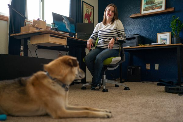 Heather Aruffo does medical writing from her home office in South Anchorage. Her dog Oaken, a retired sled dog, keeps her company. Photographed on Thursday, June 3, 2021. (Loren Holmes / ADN)