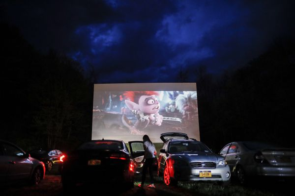 FILE - In this Friday, May 15, 2020, file photo, guests watch a showing of
