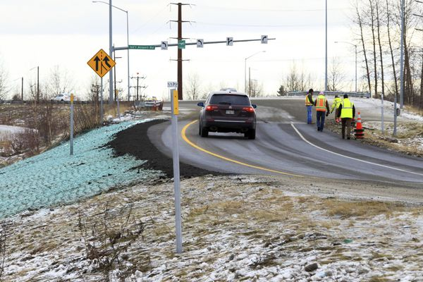 A car ascends a newly repaired off-ramp of Minnesota Drive on Wednesday, Dec. 5, 2018, in Anchorage, Alaska. A massive 7.0 earthquake and its aftershocks rocked buildings and buckled roads Nov. 30, including the road that's a route to Ted Stevens Anchorage International Airport. Alaska transportation officials made rebuilding the ramp a priority. It reopened Tuesday, Dec. 4, and a crew completed shoulder work Wednesday. (AP Photo/Dan Joling)