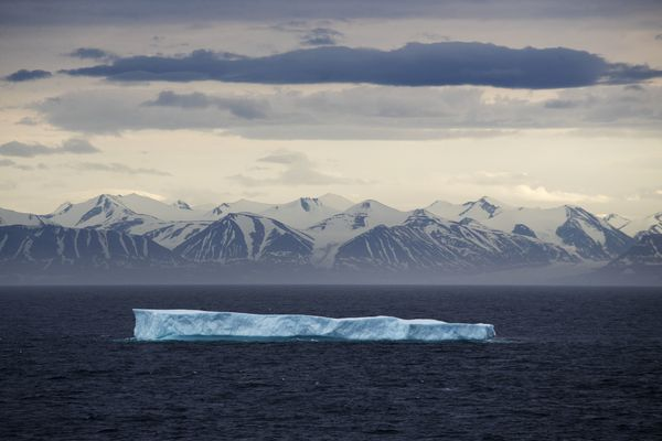 FILE - In this July 24, 2017 file photo, an iceberg floats past Bylot Island in the Canadian Arctic Archipelago. The National Oceanic and Atmospheric Administration's annual Arctic Report Card, released on Tuesday, Dec. 8, 2020, shows how warming temperatures in the Arctic are transforming the region's geography and ecosystems. (AP Photo/David Goldman, File)